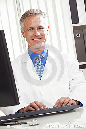 Male Hospital Doctor Using Computer