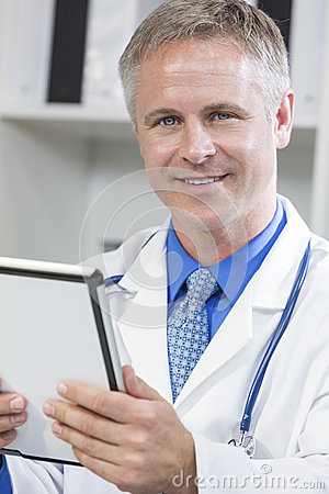 Male Hospital Doctor Using Tablet Computer