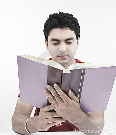 Male of indian origin reading