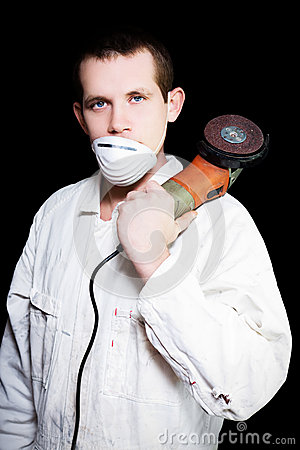 Male Industrial Steel Worker Holding Angle Grinder