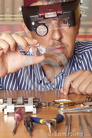 Male jeweler Focus on diamond