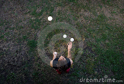 Male juggler juggling with balls from above