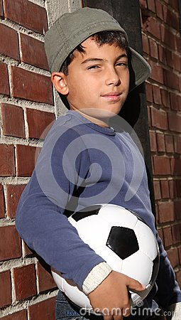 Male kid with a football