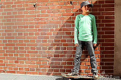 Male kid with a skateboard