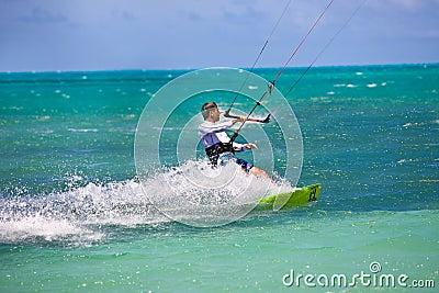Male Kitesurfer turning hard