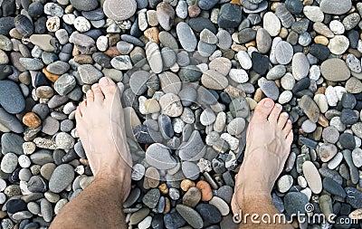 Male legs on pebble