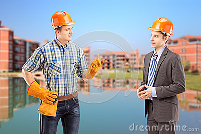 Male manual worker having a conversation with architect, constru