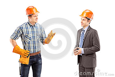 Male manual worker having a conversation with architect