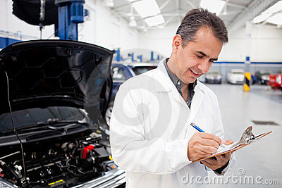 Male mechanic at a garage