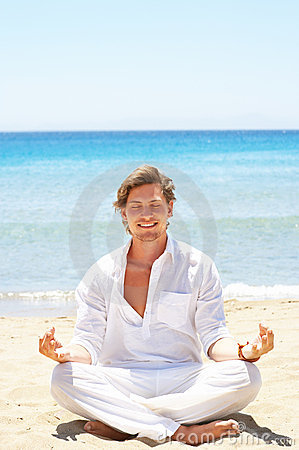 Male meditation on the beach