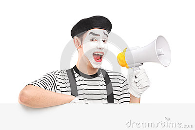 Male mime artist holding a loudspeaker and posing on a blank pan