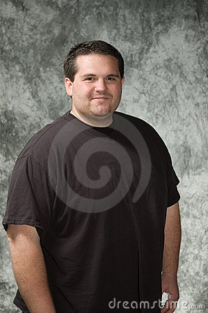 posing men for portraits. Overweight young man posing in