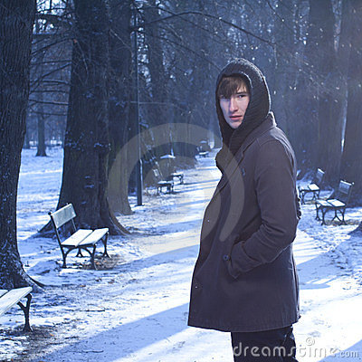 Free Male Model Looking Back, In A Cold Winter Scenery. Royalty Free Stock Images - 23531289