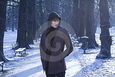 Male model in winter alley, cold blue background