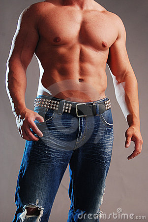 Male muscle in jeans