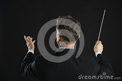 Male Music Conductor Directing With His Baton