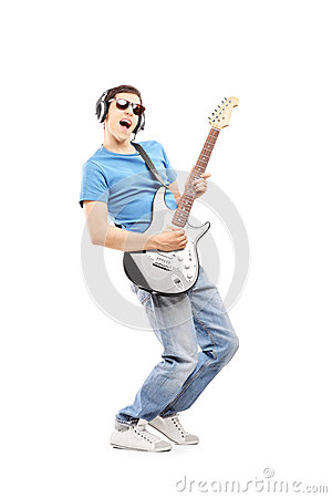 Free Male Musician With Headphones Playing An Electric Guitar Stock Photo - 33539120
