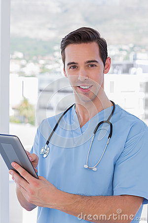 Male nurse holding a tablet pc