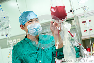 Male nurse to observe blood bag Editorial Photo