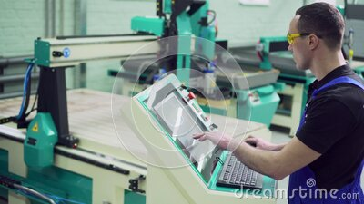 The operator of the CNC machine. stock footage
