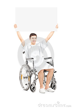 Male patient in a wheelchair holding a blank panel
