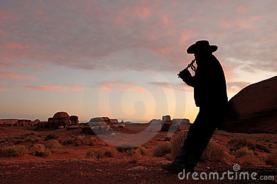 Male Playing Flute in the Desert