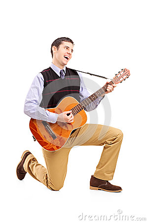 Male playing a guitar and singing