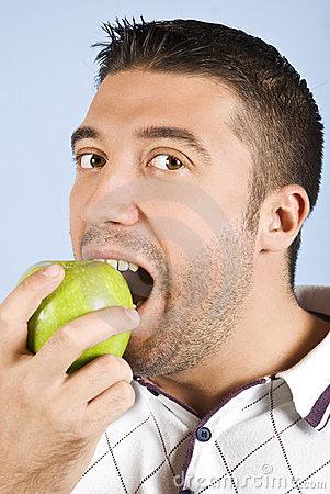 Male portrait taking a bite of an apple