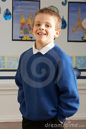 Male Primary School Pupil Standing In Classroom