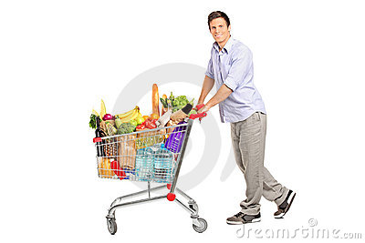Male pushing a shopping cart full with groceries