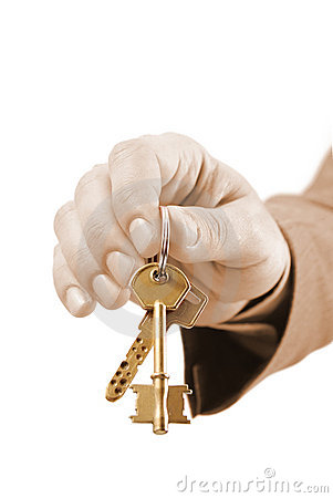 Male real estate executive hand holding two keys.