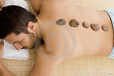 Male relaxing for hot stone treatment