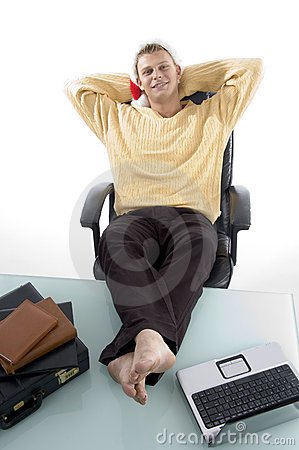 Male in relaxing mode with legs on desk
