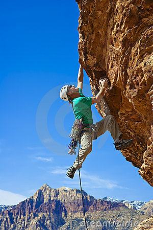 Free Male Rock Climber Reaching For The Summit. Stock Photo - 13790130