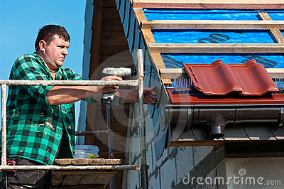 Male roofer at work