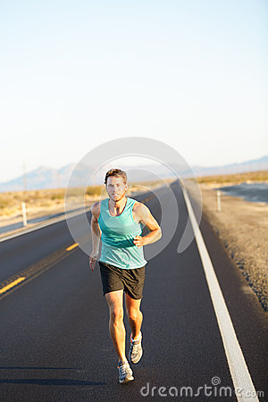 Male runner jogging and running on road in nature