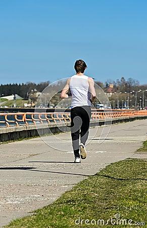 Male running on the shoreline.