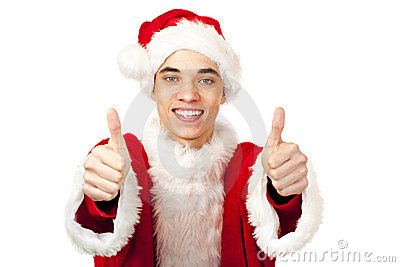Male santa claus teenager shows both thumbs up