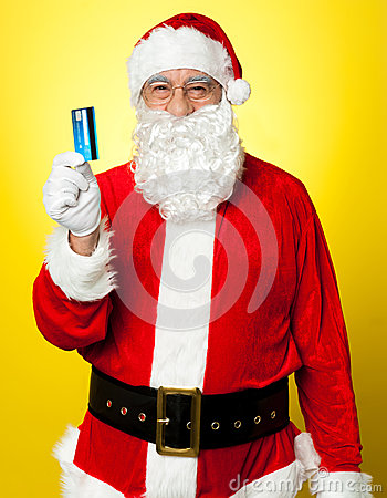 Male in Santa costume posing with his cash card