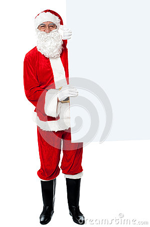 Male santa holding whiteboard