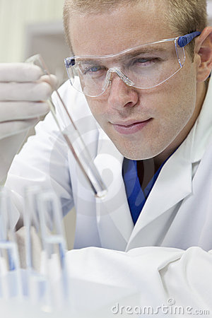 Male Scientist With Test Tube In Laboratory