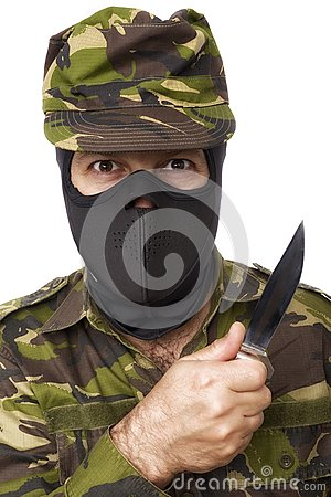 Male self defense instructor with camouflage do a self defense