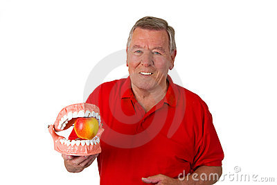 Male senior with teeth modell