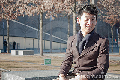 Male sitting on bench