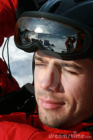 Male skier portrait and wearing goggles