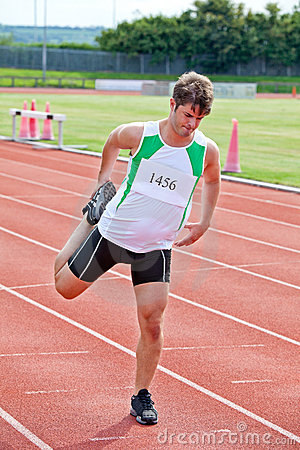 Male sprinter stretching before a race