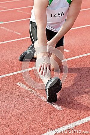 Male sprinter warming up