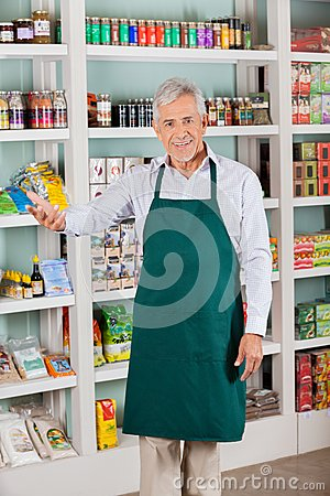 Male Store Owner Gesturing In Supermarket