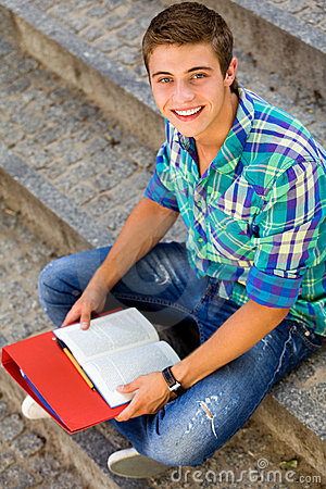 Male student sitting on stairs