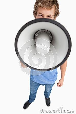 A male student speaking in a megaphone
